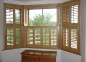 bay-window-wooden-shutters