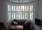 white-shutters-closed-for-a-bay-window-in-berkhamsted