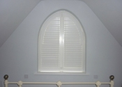 arched-white-shutters