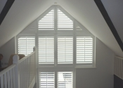 white-shaped-shutters-remote-control