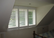 white-shutters-in-dormer-window