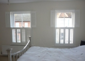 white-portland-shutters-bedroom-st-albans